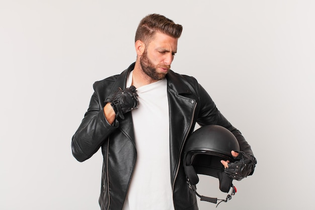 Young handsome man feeling stressed, anxious, tired and frustrated. motorbike helmet concept