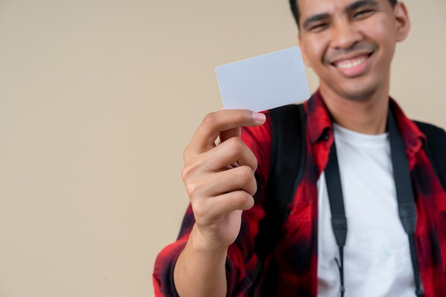 Young handsome man hand holding blank white credit card