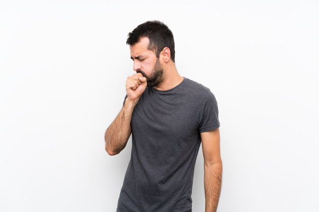 Young handsome man  is suffering with cough and feeling bad
