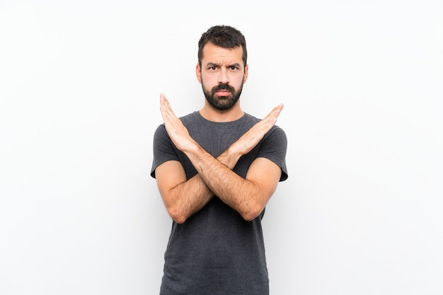 Young handsome man over isolated white background making no gesture