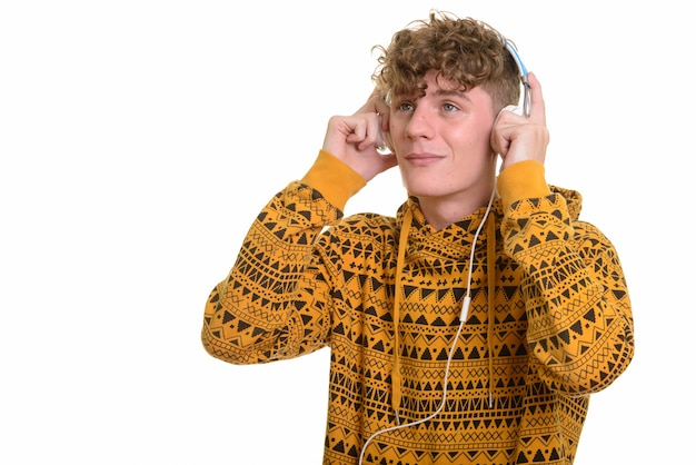 Young handsome man listening to music while thinking