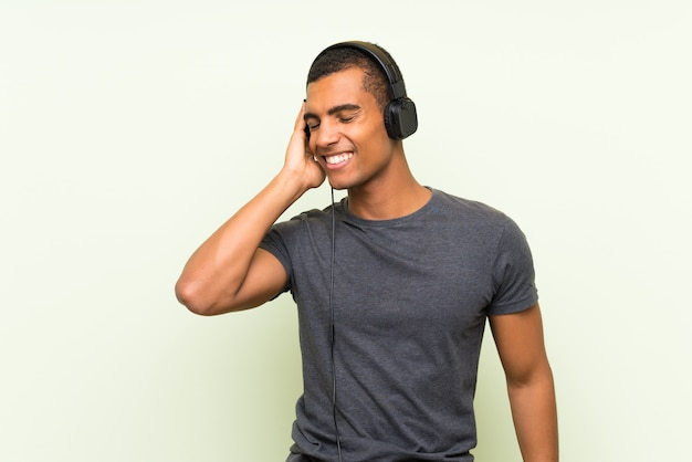 Young handsome man listening music with a mobile
