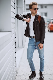 Young handsome man model posing in the street
