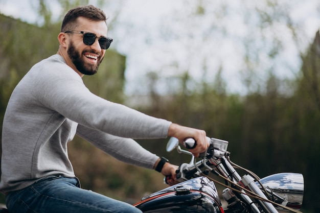 Young handsome man on motorcycle travelling