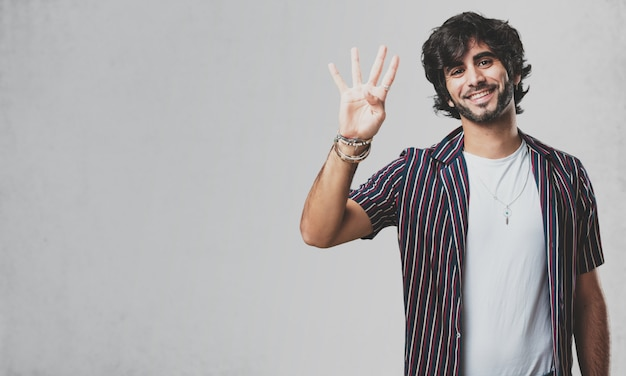 Young handsome man showing the number four, symbol of counting, concept of mathematics