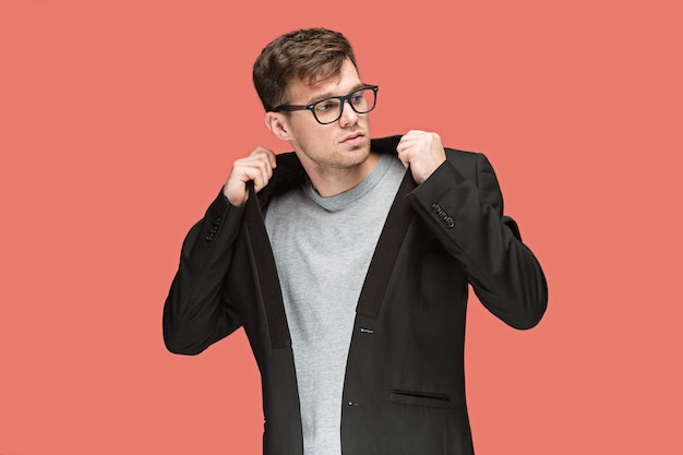 Young handsome man in suit and glasses