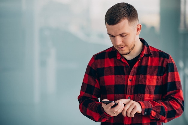 Young handsome man using phone