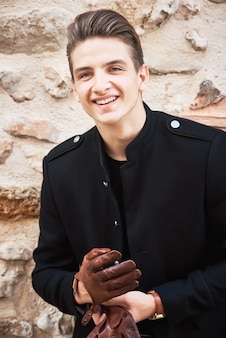 Young handsome man wearing black clothes