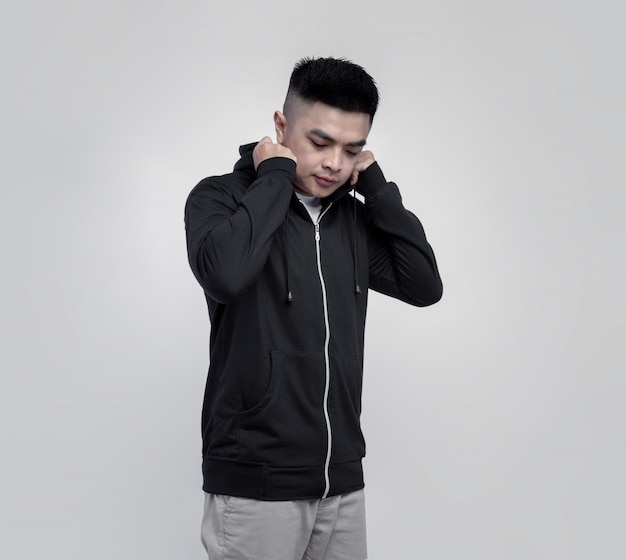 Young handsome man wearing black hoodie zipper isolated on background suitable for mockup
