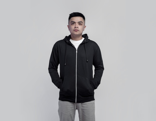 Young handsome man wearing black hoodie zipper isolated on space suitable for mockup