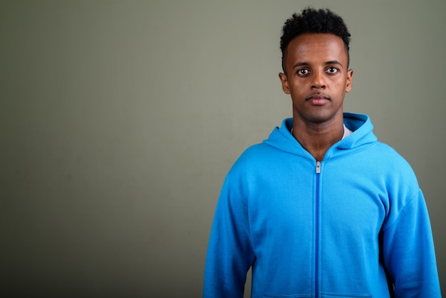 Young handsome man wearing blue hoodie