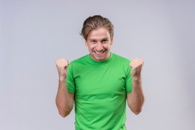 Young handsome man wearing green t-shir