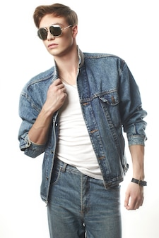 Young handsome man wearing jeans jaket