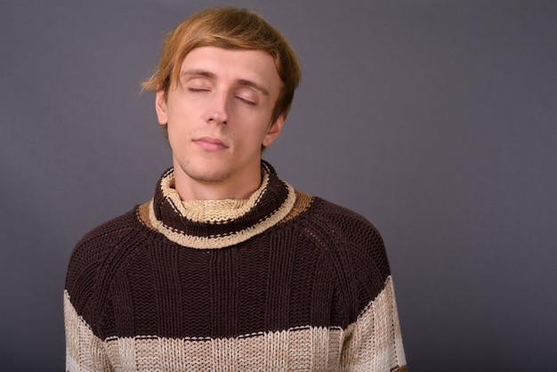 Young handsome man wearing turtleneck sweater