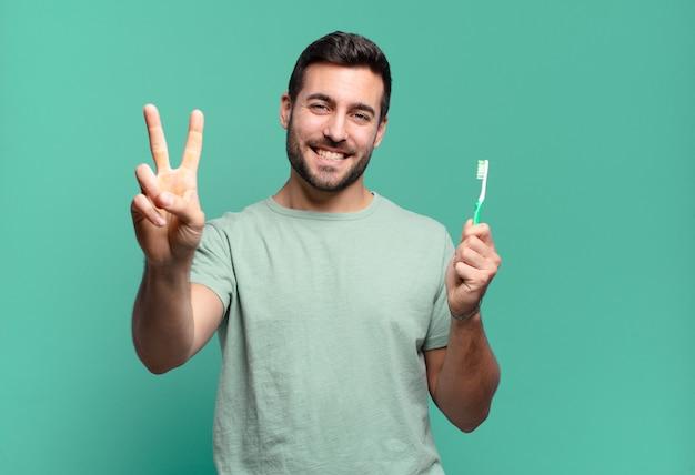 Teethbrush와 젊은 잘 생긴 남자.