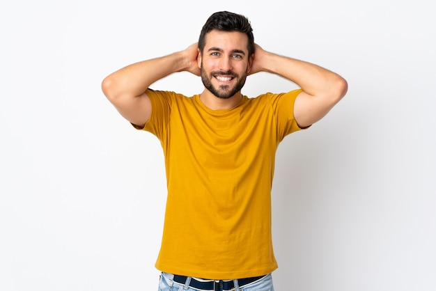 Young handsome man with beard isolated on white wall laughing