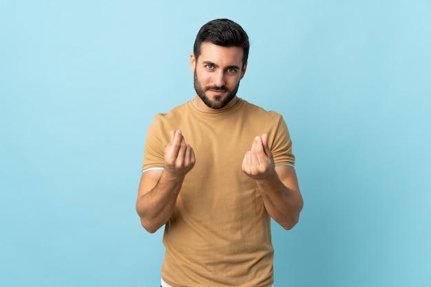 Молодой красавец с бородой делает денежный жест, но разрушен