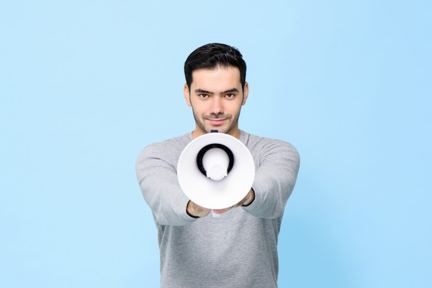 Young handsome man with megaphone isolated