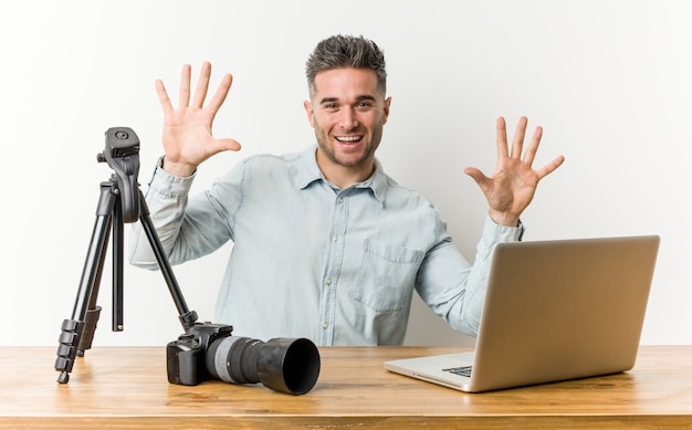 Young handsome photography teacher showing number ten with hands.
