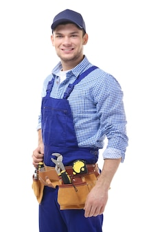 Young handsome plumber isolated on white