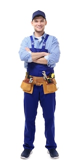Young handsome plumber with crossed hands on white background