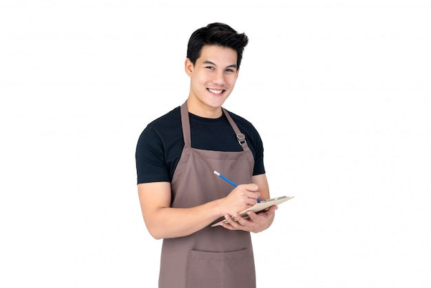 Young handsome smiling asian man barista taking order with service mind