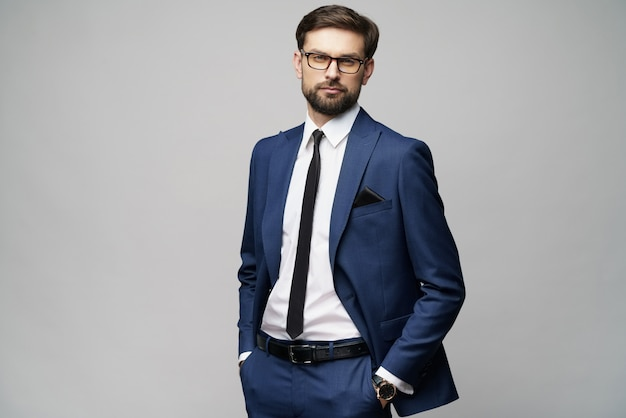 Young handsome stylish businessman wearing suit