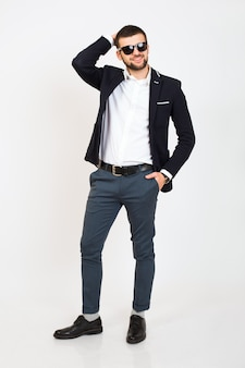 Young handsome stylish hipster man in black jacket, business style, white shirt, isolated, standing on white background, smiling, attractive, full height, looking confident and cool