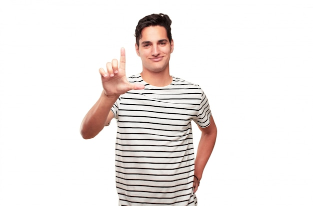 Young handsome tanned man gesturing