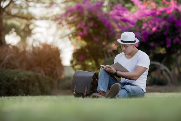 Young hansome man reading book