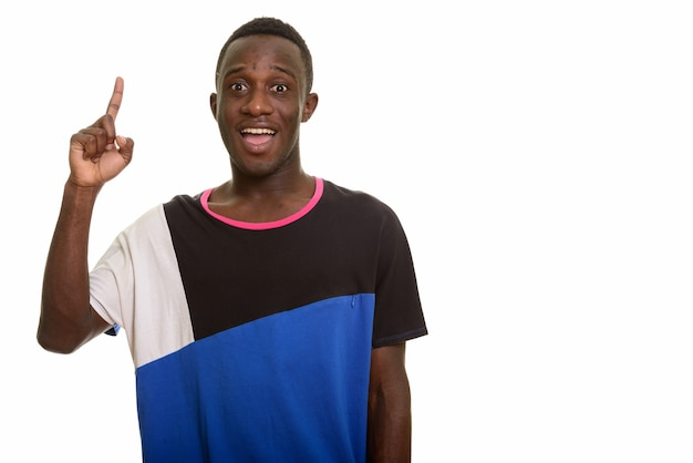 Young happy african man smiling while pointing finger up having
