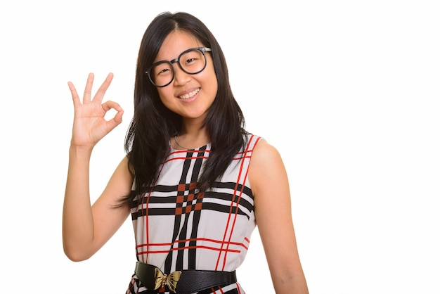 Young happy asian businesswoman giving ok sign isolated