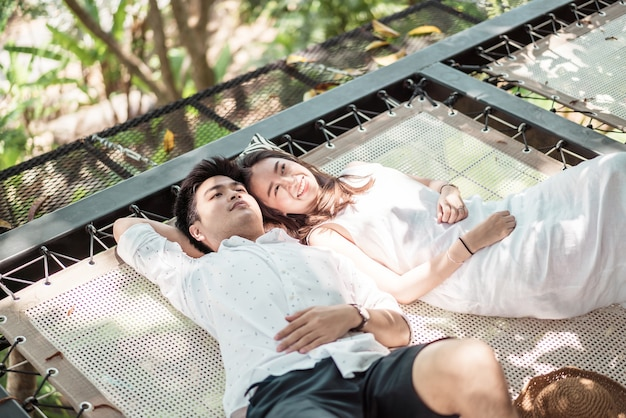 Young happy asian couple in love on cradle balcony
