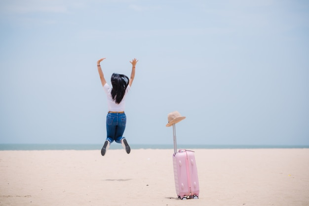 Young happy asian gril at the beach