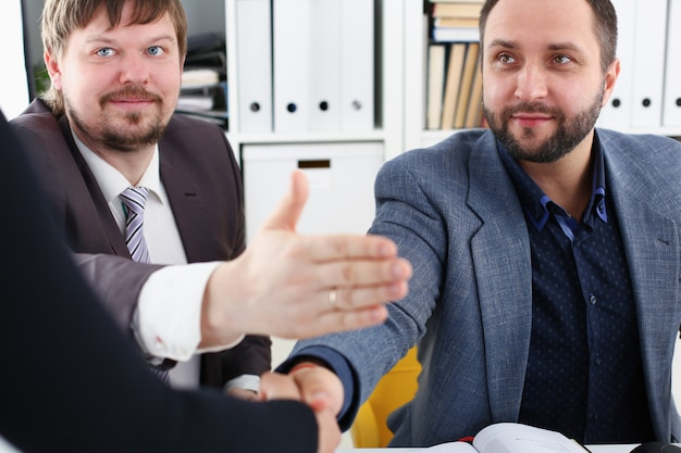 Young happy businessmen have meeting in office argue with each other have different points of view