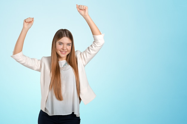 Young happy businesswoman with arms up