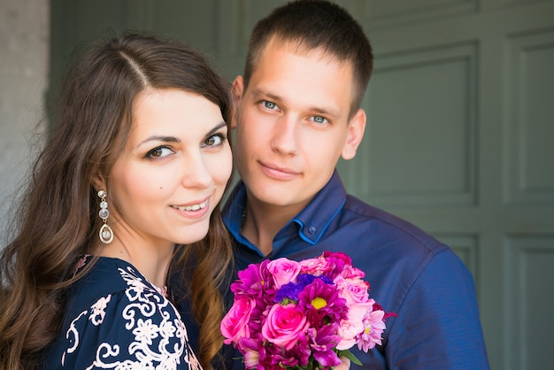 Young happy caucasian couple newlyweds looking at camera