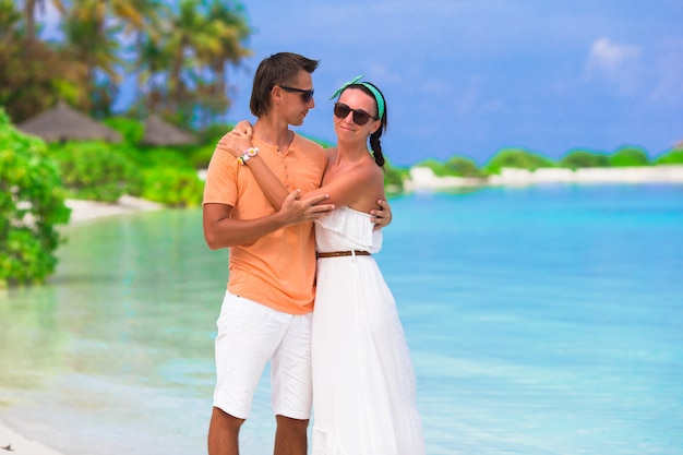 Young happy couple during beach vacation on maldives
