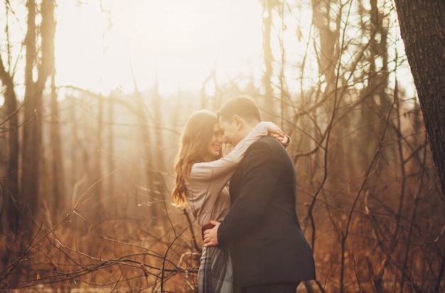 Young happy couple hugging on the nature