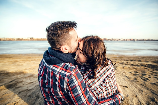 Young happy couple outdoor on the beach
