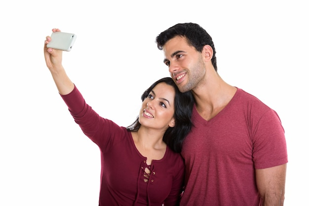Young happy couple smiling while taking selfie
