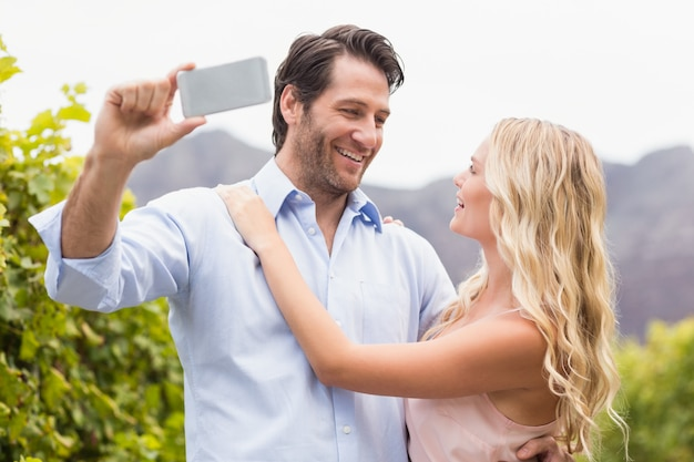 Young happy couple taking a selfie
