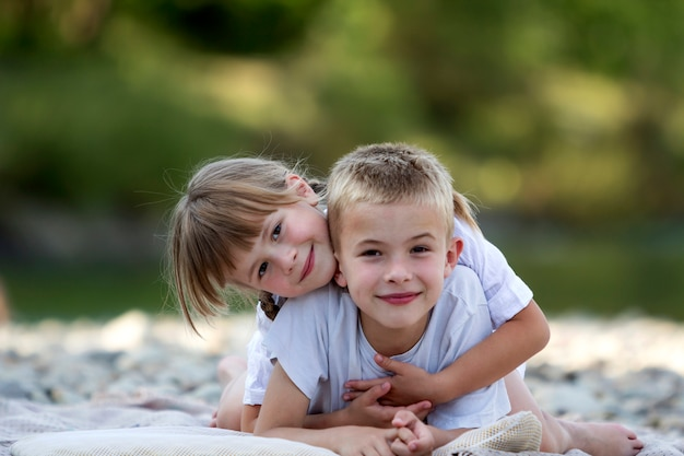 Young happy cute blond smiling children