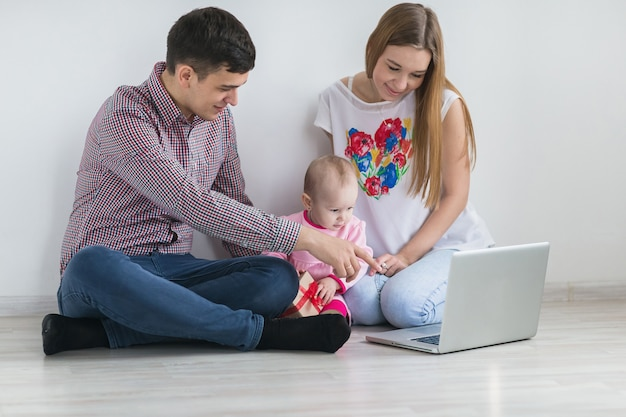 Young happy family running on a laptop