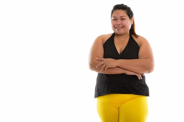 腕クロで笑って若い幸せな脂肪アジアの女性