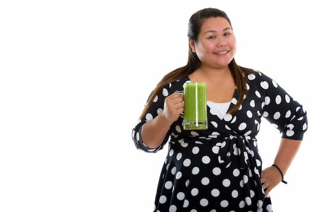 Young happy fat asian woman smiling with dress