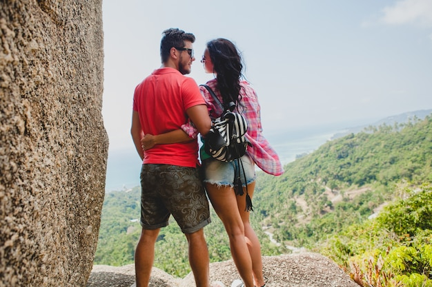 Young happy hipster couple in love traveling around world