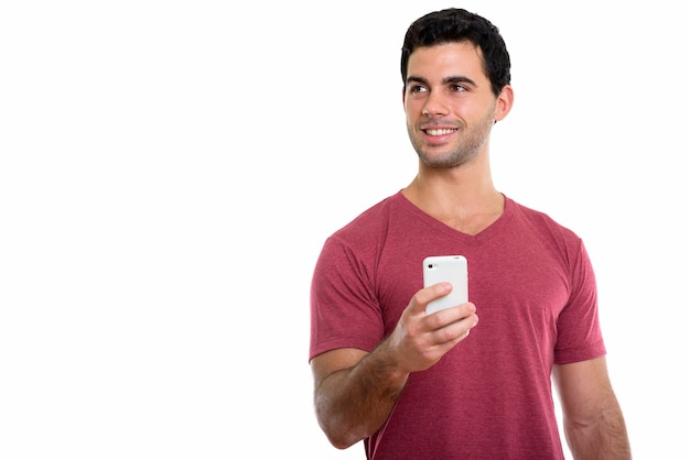 Young happy hispanic man smiling and holding mobile