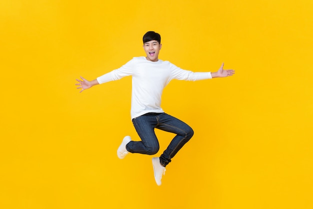 Young happy korean teen jumping welcomely