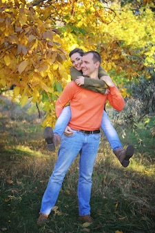 Young happy love couple in autumn park